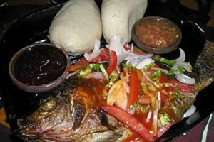 Banku and Tilapia, a local delicacy.